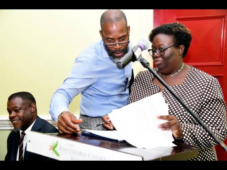 Chairman of Kingston Properties Garfield Sinclair consults with KPMG representative  Nadine Williams on the auditors report, at the company's annual general meeting on Tuesday, May 28, 2019, held at Knutsford Court Hotel in New Kingston.