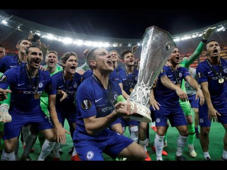 Chelsea captain Cesar Azpilicueta celebrates with the trophy after winning the Europa League final match between Arsenal and Chelsea at the Olympic Stadium in Baku, Azerbaijan, yesterday. Chelsea won 4-1.