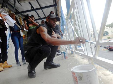 Bounty Killer painting a section of KPH on Labour Day.
