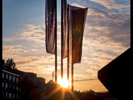European flags blow in front of the European Central Bank as the sun rises in Frankfurt, Germany, on Sunday, May 26.