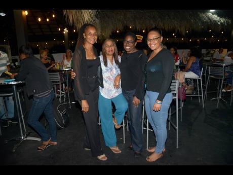 From left: Elaine Wint, Lallique Sundalyah, Nicole O'Reggio and Rochelle Kildare enjoyed every minute of the jazz-fusion night.