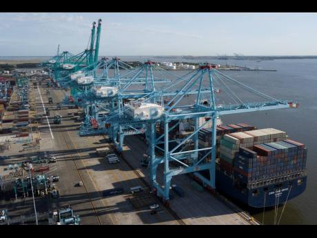 A container ship is unloaded at the Virginia International Gateway terminal in Norfolk, Virginia.