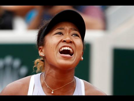 Japan's Naomi Osaka screams after scoring a point against Victoria Azarenka of Belarus during their second-round match of the French Open tennis tournament at the Roland Garros stadium in Paris yesterday.