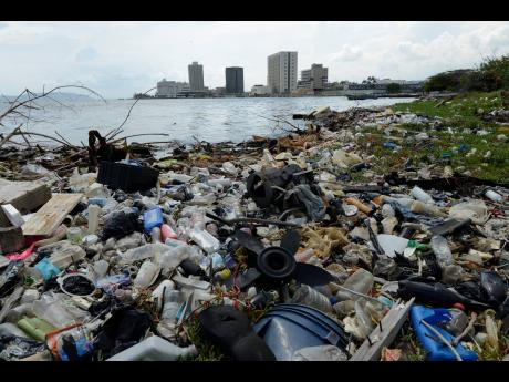 Garbage litters the coastline of Kingston, Jamaica's capital city, with high-rises of downtown dotting the skyline. Despite the Labour Day clean-up efforts by various organisations on Thursday, May 23, two days later, the coastline was awash with plastic pollutants.