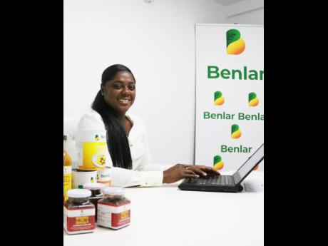 Benlar Foods CEO Craslyn Benjamin with products ready for export.