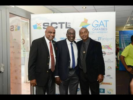 We're buddies! (From left) Pals Dr Fritz Pinnock, Ruel Reid, and Balfour Peart pose for a snap. Contributed