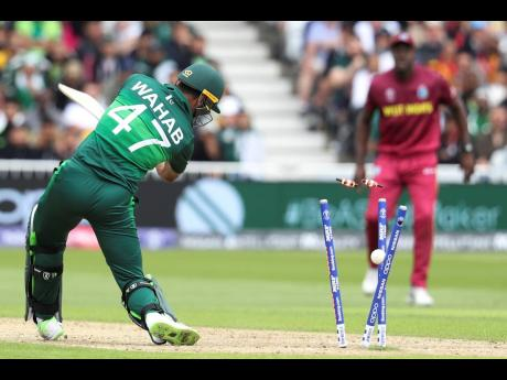Pakistan's Wahab Riaz is bowled by the Windies' Oshane Thomas during their ICC World Cup match at Trent Bridge cricket ground in Nottingham, England this morning.