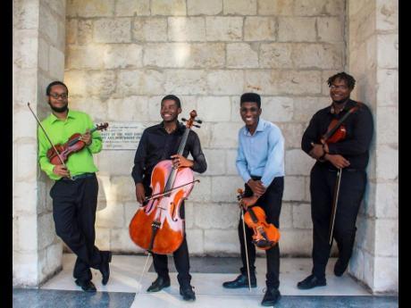 The Accel String Quartet from left:  Devoy Ellis, Alex Lawson, Kamoy Gordon, and Gabriel Walters.