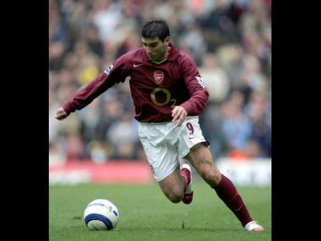 FILE - In this file photo dated Saturday April 1, 2006, Arsenal's Jose Antonio Reyes runs with the ball during their English Premier League match against Aston Villa at Highbury stadium in London.