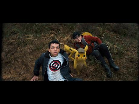 Ryan Reynolds as Pikachu with Justice Smith and Kathryn Newton in 'Pokémon Detective Pikachu'.