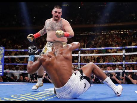 Andy Ruiz knocks down Anthony Joshua during the third round of a heavyweight title boxing match at Madison Square Garden in New York on Saturday. Ruiz won in the seventh round.