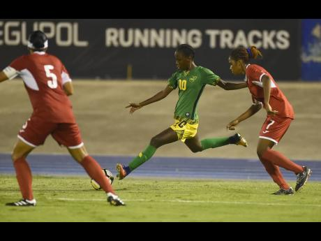 Jamaica's Jody Brown (centre) proves too much to handle for Cuba's Maristania Mengana Perez (right) and Yarisleidy Mena Novo during their Concacaf Caribbean Women's Championship game, which also served as a prelimary-round FIFA Women's World Cup qualifier at the National Stadium on Sunday, September 2, 2018.