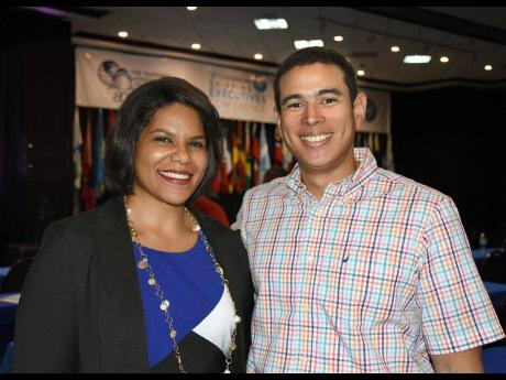 Women in Maritime WiMAC representative Lisa Russell shares a moment with Caribbean Shipping Association President Juan Carlos Croston after her presentation at the 18th annual Caribbean Shipping Executives' Conference on May 21.