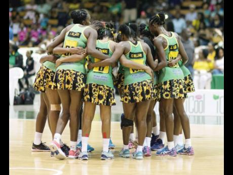 Members of Jamaica's national senior women's netball team, the Sunshine Girls, huddle during a match against England in the Sunshine Series at the National Indoor Sports Centre on Saturday, October 13, 2018.