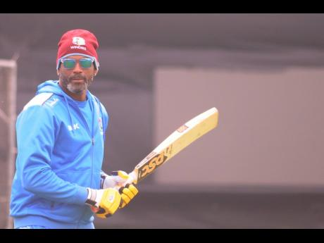 Windies head coach Floyd Reifer engaging in batting practice with his team in a training session at Trent Bridge, Nottingham, England, yesterday ahead of Thursday's ICC World Cup match with Australia.