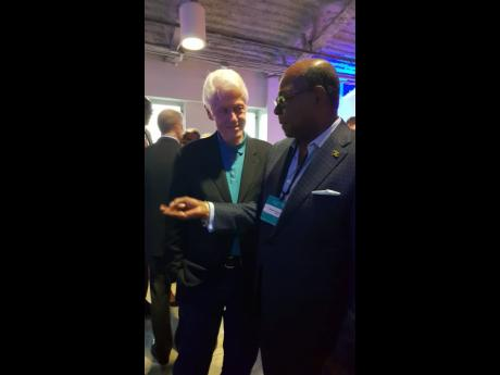 Tourism Minister Edmund Bartlett engages former US President Bill Clinton in discussion on the Global Tourism Resilience and Crisis Management Centre in the US Virgin Islands. Clinton showed great interest in supporting the centre and its objectives of building resilience in the region.