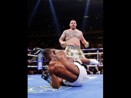 Andy Ruiz Jr knocks down Anthony Joshua during the third round of a heavyweight championship boxing match on Saturday, June 1, in New York. Ruiz won in the seventh round.