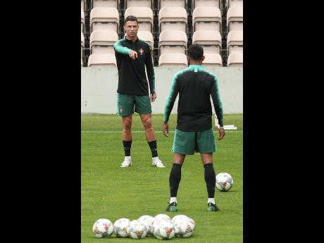 Portugal's Cristiano Ronaldo gestures during a training session at the Bessa stadium in Porto, Portugal, yesterday. Portugal will face Switzerland today in a UEFA Nations League semi-final.