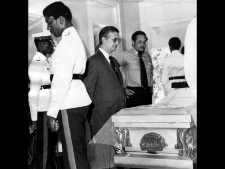 In this August 15, 1977, Gleaner file photo, then Opposition Leader Edward Seaga takes a final look at the body of  Sir Alexander Bustamante at the funeral for Jamaica's first prime minister.
