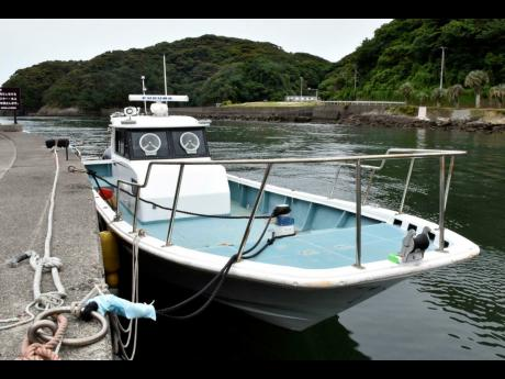 The boat in which police confiscated drug is seen at a wharf in Minami Izu town, Shizuoka prefecture, south of Tokyo, Wednesday, June 5.