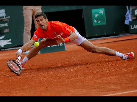 Serbia's Novak Djokovic plays a shot against Germany's Alexander Zverev during their quarter-final match of the French Open tennis tournament at the Roland Garros stadium in Paris, France, yesterday.