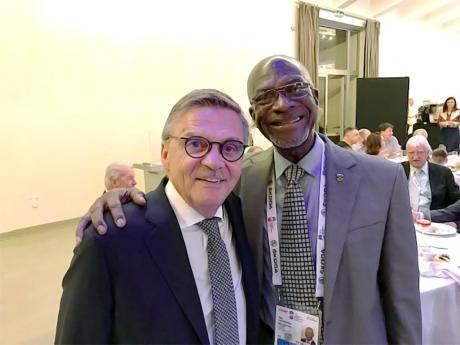 Jamaica Olympic Ice Hockey Federation director Don Anderson (right) with International Ice Hockey Federation president Rene Fasel at the global body's annual congress in Slovakia recently.