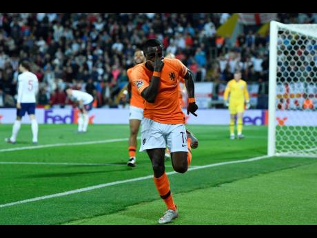 Netherlands' Quincy Promes celebrates after scoring his side's second goal against England during their UEFA Nations League semi-final match at the D. Afonso Henriques Stadium in Guimaraes, Portugal yesterday. AP