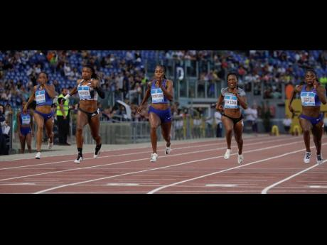 Jamaica's Elaine Thompson (centre) on her way to victory, ahead of Great Britain's Dina Asher-Smith (right), Ivorian Marie-Josée Ta Lou (second right), and Americans Aleia Hobbs (second left) and English Gardiner in the women's 100m event, at the Rome leg of the IAAF Diamond League in Italy, yesterday.