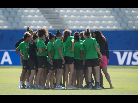 Jamaica's Reggae Girlz familiarise themselves with the playing surface at the Stade des Alpes yesterday, ahead of this morning's important FIFA Women's World Cup Group C clash with Brazil.