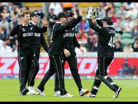 New Zealand wicketkeeper Tom Latham (right) celebrates taking the wicket of Afghanistan's Najibullah Zadran with teammates, during their ICC Cricket World Cup group stage match at the County Ground Taunton, England, yesterday.