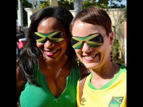 Kamina Johnson-Smith (right), minister of foreign affairs, and Shorna-Kay Richards, director of the Bilaterial Relations Department, Ministry of Foreign Affairs, had on matching sunglasses when they turned up at the Brazilian ambassador's residence to watch the Reggae Girlz make their debut in World Cup football against Brazil. The Girlz were defeated 3-0.