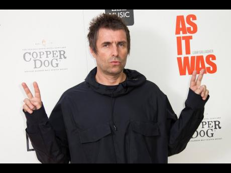 Singer Liam Gallagher poses for photographers upon arrival at  the screening for 'As it Was' at Alexandra Palace in north London on Thursday.
