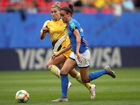 Australia's Steph Catley challenges Italy's Barbara Bonansea (right) during their FIFA Women's World Cup Group C match at the Stade du Hainaut in Valenciennes, France, yesterday.