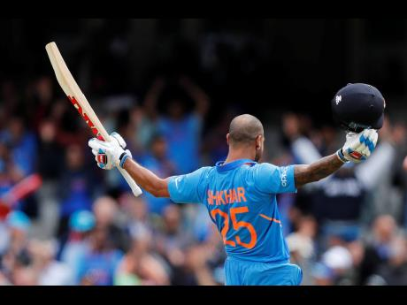 India's Shikhar Dhawan celebrates his century scored against Australia during their ICC Cricket World Cup match at the Oval in London, England, yesterday.