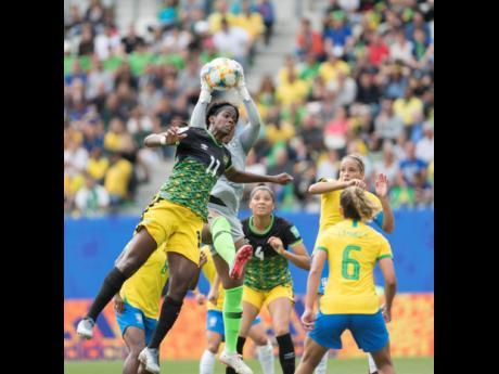 Jamaica's Khadija Shaw (left) is denied a header by Brazil goalkeeper Babara.