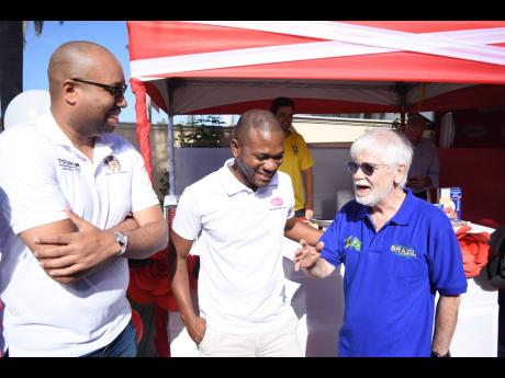 Brazilian Ambassador to Jamaica, His Excellency Carlos Alberto M. den Hartog (right) welcomes Delano Seiveright (left), Strategist and Senior Advisor in the Ministry of Tourism, and Omar Palmer, LASCO Distributors Limited Consumer Division Marketing Manager, to the 'Bramaican Breakfast' kick-off event, recently.