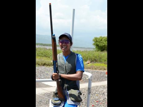 Cameron Phang Sang is all smiles after winning the National Commercial Bank Junior Sporting Clays Open Championship at the Jamaica Skeet Club range in Portmore, St Catherine, on Sunday.