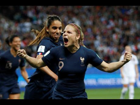 France's Eugenie Le Sommer (front), celebrates with teammate Amel Majri after scoring her side's second goal on a penalty kick during the FIFA Women's World Cup Group A match with Norway in Nice, France yesterday.