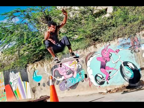A skateboarder doing stunts in the Harbour View community.