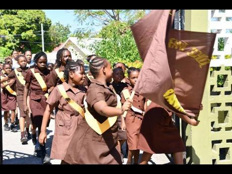 Members of the Catherine Hall Primary, Infant and Special Education School Brownies march on June 4.
