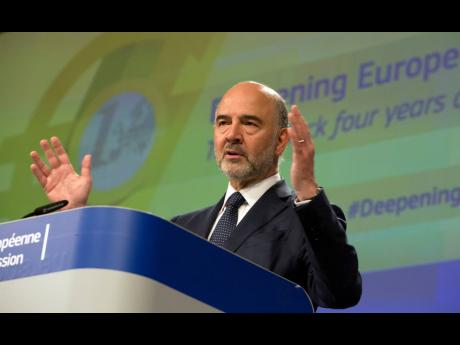 European Commissioner for Economic and Financial Affairs Pierre Moscovici speaks during a media conference at the EU headquarters in Brussels, on Wednesday, June 12.