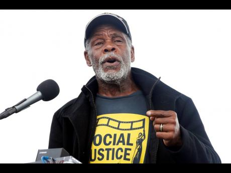 Actor Danny Glover speaks at the ACT To End Racism rally  in 2018.