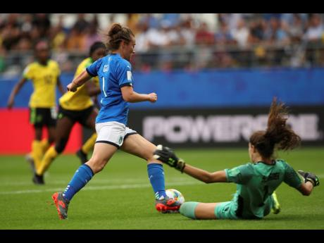 Italy's Aurora Galli (left) rounds Jamaica goalkeeper Sydney Schneider to score her side's fifth goal during their FIFA Women's World Cup Group C match at the Stade Auguste-Delaune in Reims, France this afternoon.