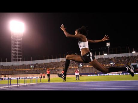 Shanieka Ricketts speeds down the runway to set a meet record of 14.69m in the women's triple jump event at the Racers Adidas Grand Prix at the National Stadium last Saturday.