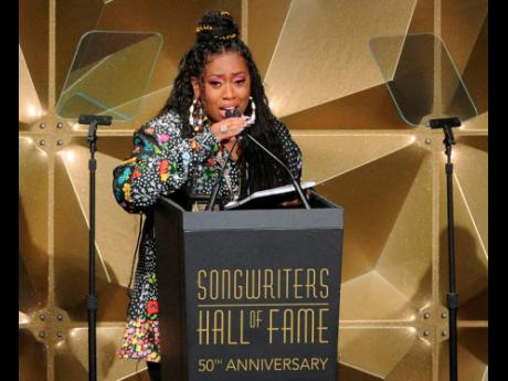 Missy Elliott speaks at the 50th annual Songwriters Hall of Fame induction and awards ceremony at the New York Marriott Marquis Hotel on Thursday.