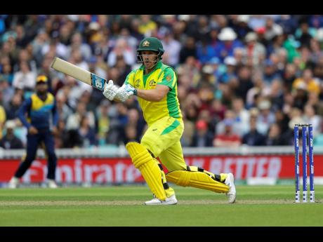Australia captain Aaron Finch plays a shot off the bowling of Sri Lanka's Nuwan Pradeep during their ICC World Cup cricket match at The Oval in London, England, yesterday.
