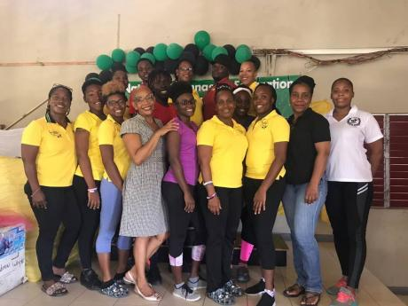 Jamaica Amateur Gymnastics Association board members and coaches in attendance at a workshop held at the Pembroke Hall Gym on Saturday, June 8. Front row (from left): Nicole Grant Brown, Showna Robinson, Shikaira Grant, Carmen Clarke – personal development trainer and life coach, Ashmonique Goodridge, Nadeen Whyte, Tamika Jackson, Crystal Henderson, Clover Gardener, and AshleySalmon. Back row (from left): Paula White, Jonair Needham, Kimani Airy, Kerieon Grant, Shalto Stanley, and Deborah Bennett.