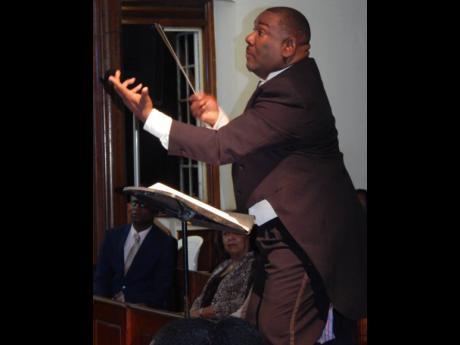 Franklin Halliburton conducting the Philharmonic Orchestra of Jamaica.