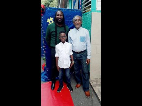 From left: Barrington Pettigrew Jr with his father, Barrington Sr, and son, Jahbari, pose for a family photo on the red carpet at Vaz Preparatory School's 'It's a King Affair'.
