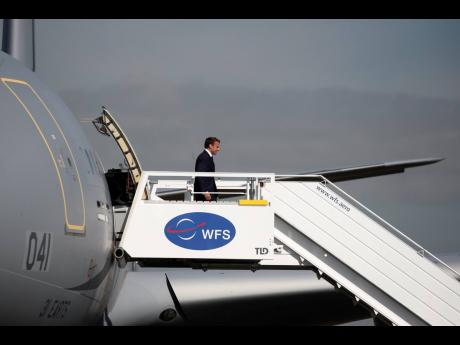 French President Emmanuel Macron disembarks from an Airbus A330 MRTT to attend the 53rd International Paris Air Show at Le Bourget Airport near Paris, France, Monday June 17.